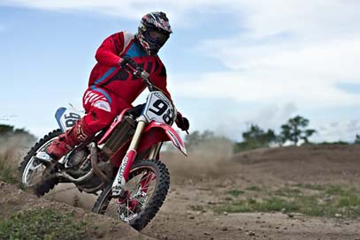 Speed-Curve Dirt-Bike Rider Motocross